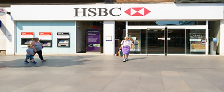 Exeter, Devon, United Kingdom - August 23, 2016: Customer came out of HSBC branch on High Street. HSBC claims it saved customers £100m in fees since it launched it's overdraft text alert in 2014.