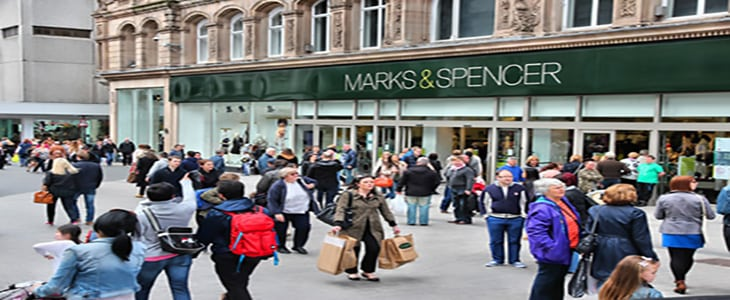 Liverpool, UK - April 20, 2013: People visit Marks & Spencerin Liverpool, UK. M&S is a major retailer with 1,010 stores in 41 countries. It specializes in fashion and luxury goods.