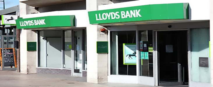 Cardiff, Wales, UK, August 31, 2016: Lloyds bank advertising sign outside the entrance to their retail branch in Queen Street