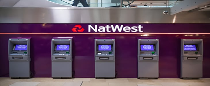 London, UK - April 17, 2018 - Row of ATM machines from the Nat West bank at Paddington station