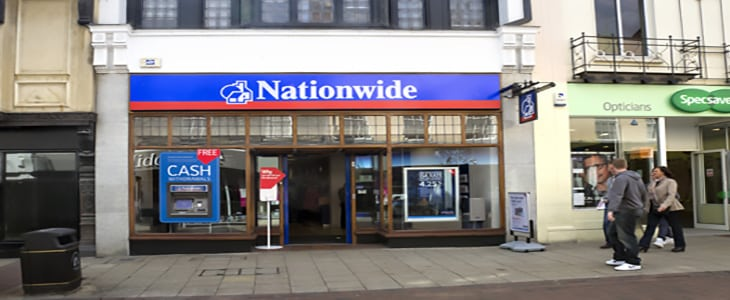 Ipswich, Suffolk, England - April 14, 2012: The Nationwide Building Society in Tavern Street, central Ipswich, Suffolk, with pedestrians. The Nationwide started life as the Provident Building Society in Wiltshire in 1846; over a hundred mergers with other building societies have taken place since then, making the Nationwide the UK's third largest mortgage lender and second largest savings provider by 2011. The Nationwide has resisted the trend for de-mutualisation and is now the largest building society in the world.